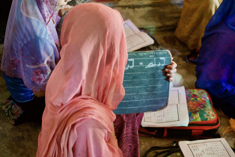 Students practicing to write Rohingya Zuban