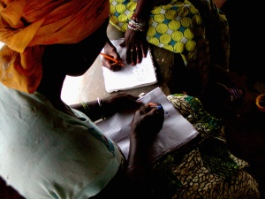 women learning to write community recruitment intern